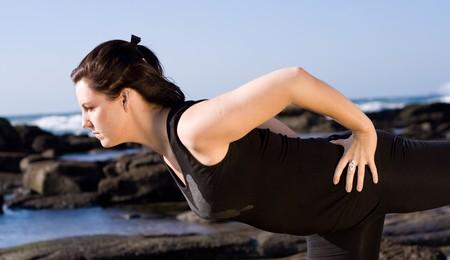 yoga woman on the beach photo