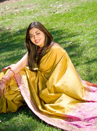 indian woman sitting on grass