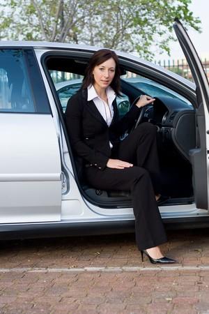 beautiful businesswoman in a silver car photo