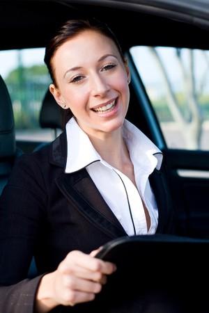 beautiful businesswoman inside a car photo
