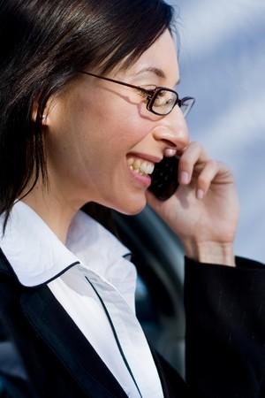 beautiful businesswoman talking on cellphone inside a car photo