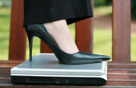 woman stepping on a laptop computer Stock Photo - 3970051