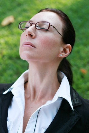 smart woman relax in the park stress free photo
