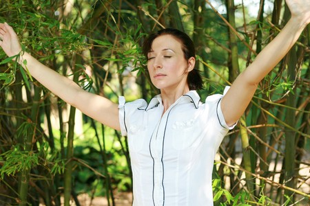woman relax in bamboo forest photo