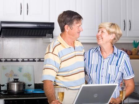 happy senior couple hugging together photo