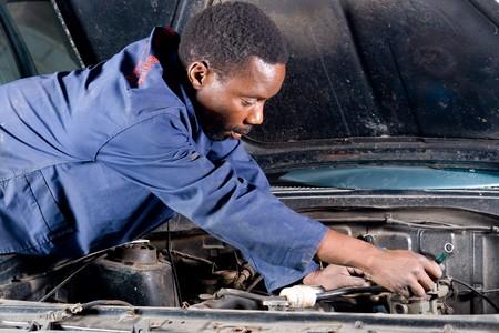 mechanic working on a vehicle photo