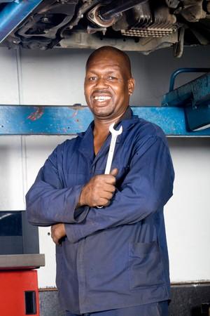 happy african mechanic portrait