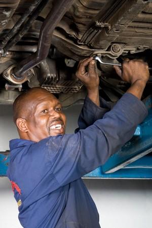african mechanic working on a vehicle photo