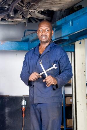 african mechanic inside garage photo