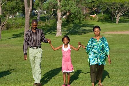 happy family walking in the park Stock Photo - 4255789