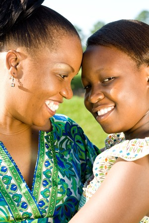 africa kiss: happy african american mother and daughter together