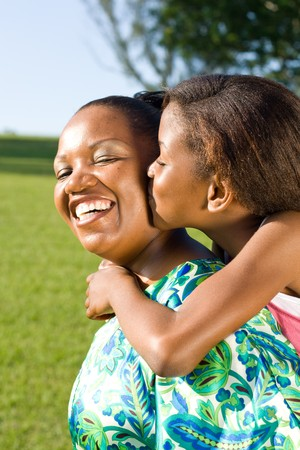 africa kiss: happy african mother and daughter together