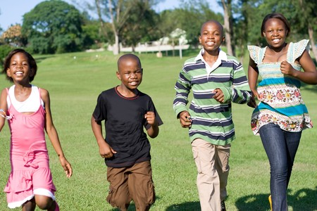 adolescent african american: african children running in the park towards camera