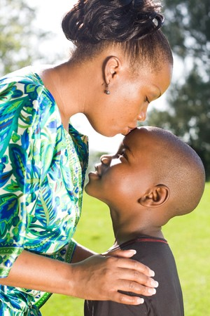 happy african: happy african mother kissing son