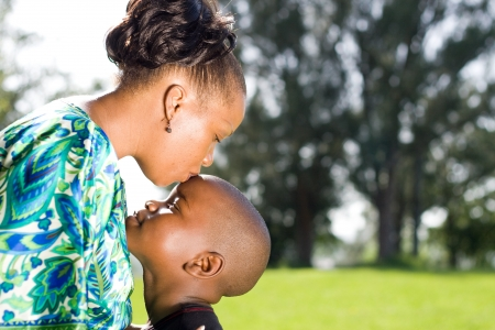 happy african mother kissing son