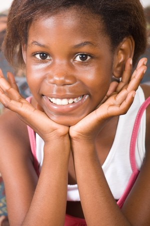 young african small girl on sofa portrait photo