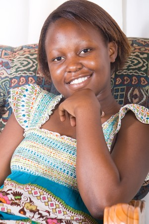 jamaican adult: young african teenager girl on sofa portrait
