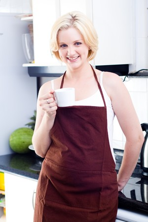 woman drinking coffee in the kitchen photo