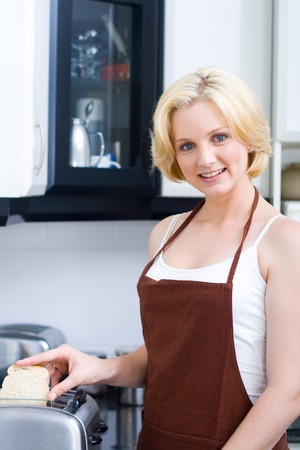woman making breakfast in the kitchen photo