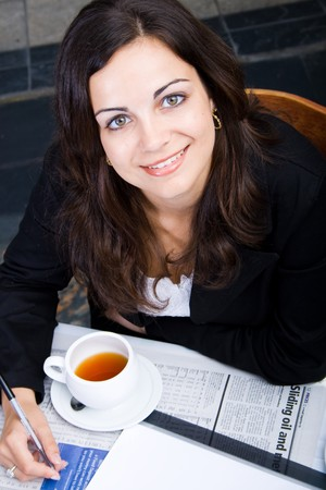 Young Business Woman drinking tea and smiling photo