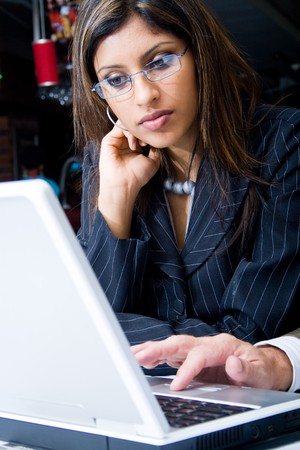 hard working woman: indian businesswoman concentrate on a laptop computer Stock Photo