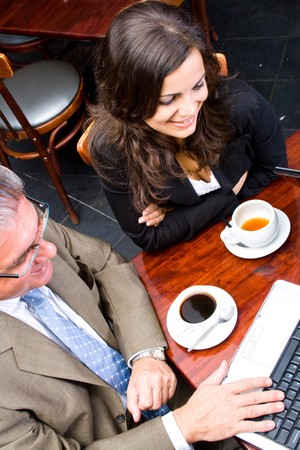 Overhead view of two business people meeting in a cafe photo