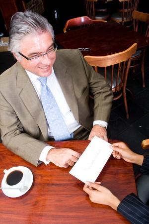 business woman handing in a letter of resignation to her boss photo