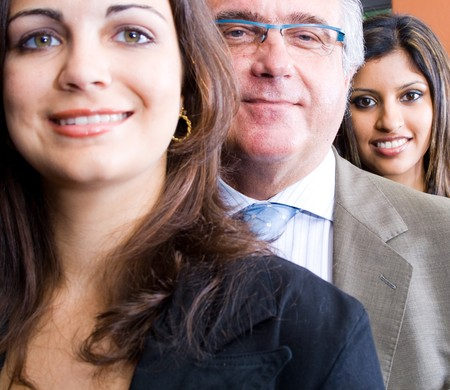 senior business man and two young business woman Stock Photo - 4117059