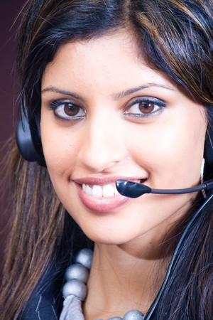 smiling indian business woman with headphones photo