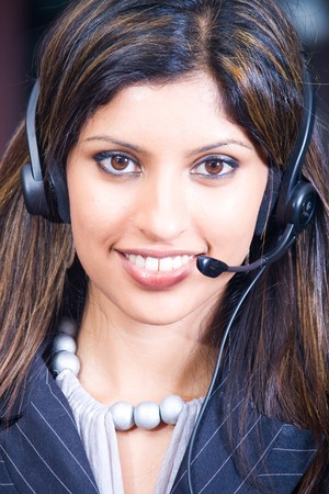 smiling indian business woman with headphones Stock Photo - 4117311