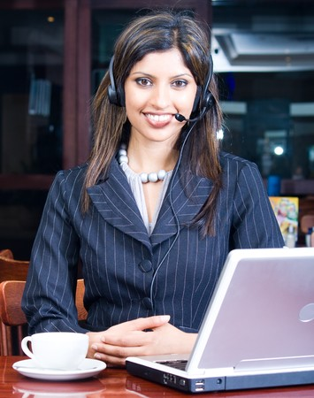 indian business woman with headset and laptop Stock Photo - 4117211