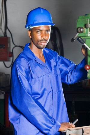 African machinist operating a drilling machine photo