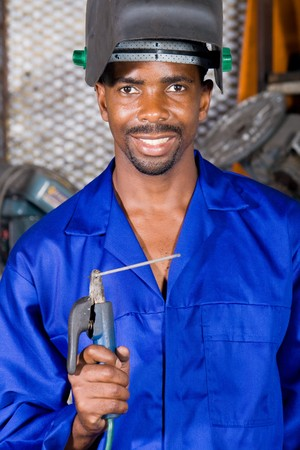 african male welder with welding equipment photo
