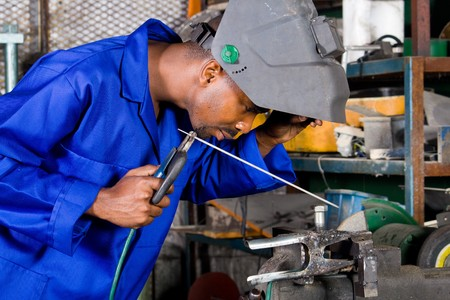 apprentice: african male welder with welding equipment Stock Photo
