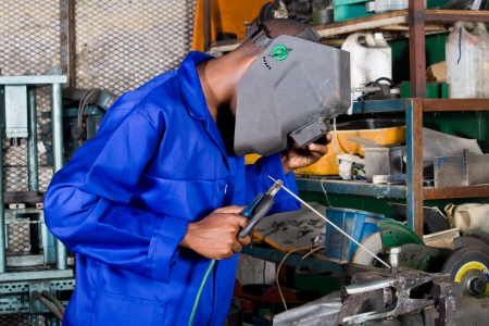 electrical engineer: african male welder with welding equipment Stock Photo