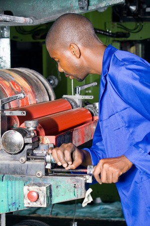plastic bag printing press operator and machine photo