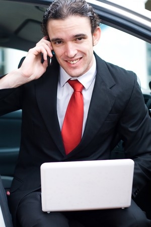 young business man working out side of office photo