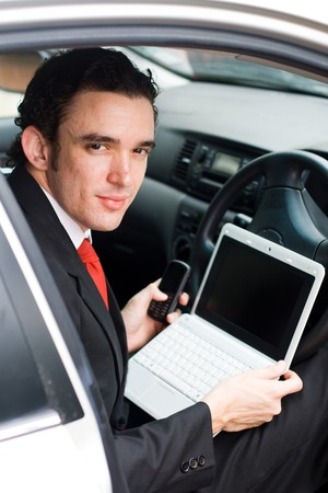 stockbroker: businessman inside a car
