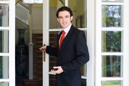 opening glass door welcomes you
