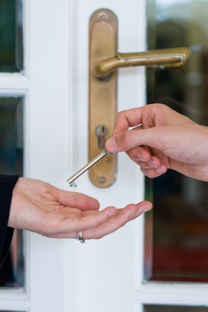 handing over the house key Stock Photo - 4581880