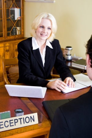 concierge: hotel manager at reception with customer Stock Photo