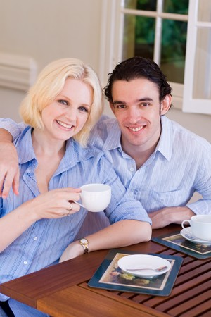 young couple drinking coffee at home Stock Photo - 4582752