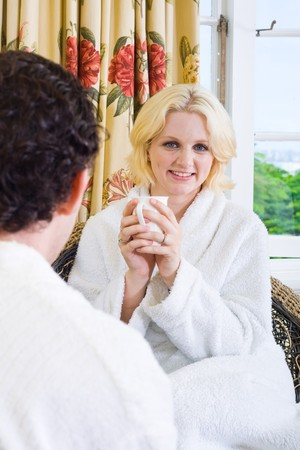 couple in bathrobe chatting in the bedroom photo