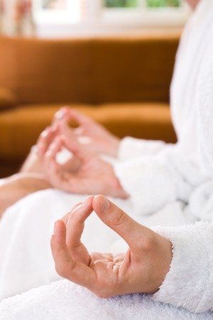woman's hand resting on her knee with fingers in yoga meditation pose Stock Photo - 4582019