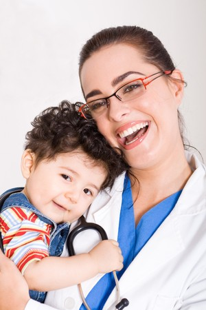 pediatric: young smiling female pediatrician holding a cute baby boy