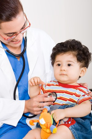 female pediatrician checking cute baby boy
