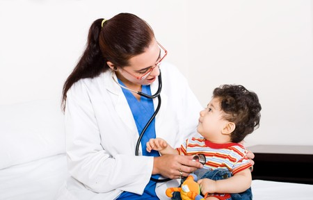 female pediatrician checking cute baby boy Stock Photo - 4411265