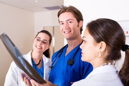 torax: three doctors looking at patients x-ray film Stock Photo