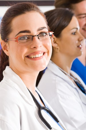 torax: female doctor portrait with colleagues Stock Photo