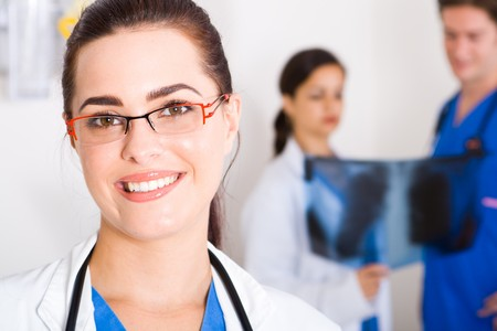 smiling female beautiful doctor in hospital photo